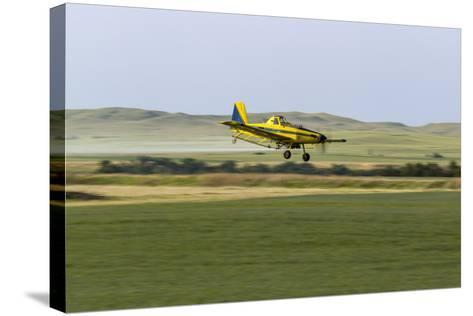 Crop Duster Airplane Spraying Farm Field Near Mott, North Dakota, USA-Chuck Haney-Stretched Canvas Print