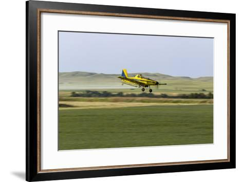 Crop Duster Airplane Spraying Farm Field Near Mott, North Dakota, USA-Chuck Haney-Framed Art Print