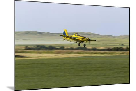 Crop Duster Airplane Spraying Farm Field Near Mott, North Dakota, USA-Chuck Haney-Mounted Photographic Print