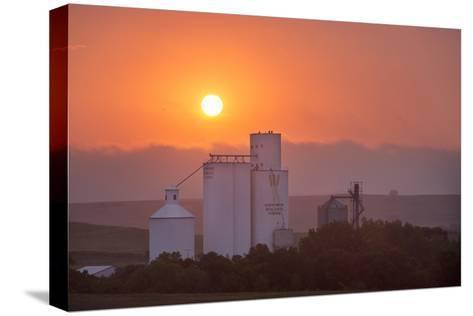Foggy Sunrise over Grain Elevator, Farm, Kathryn, North Dakota, USA-Chuck Haney-Stretched Canvas Print