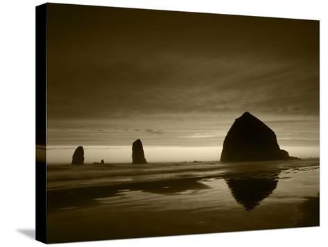 View of Haystack Rock on Cannon Beach at Sunset, Oregon, USA-Stuart Westmorland-Stretched Canvas Print