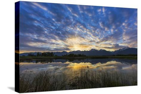 Pond Reflects the Mission Mountains, Ninepipe, Mission Valley, Montana, USA-Chuck Haney-Stretched Canvas Print