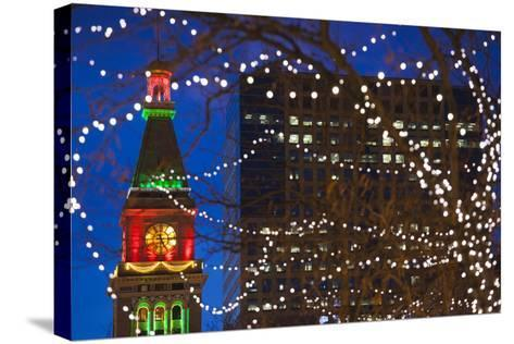 Daniels and Fisher Clock Tower with Christmas Lights, Denver, Colorado, USA-Walter Bibikow-Stretched Canvas Print