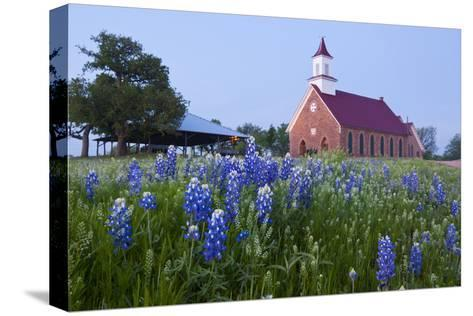 Art Methodist Church and Bluebonnets Near Mason, Texas, USA-Larry Ditto-Stretched Canvas Print