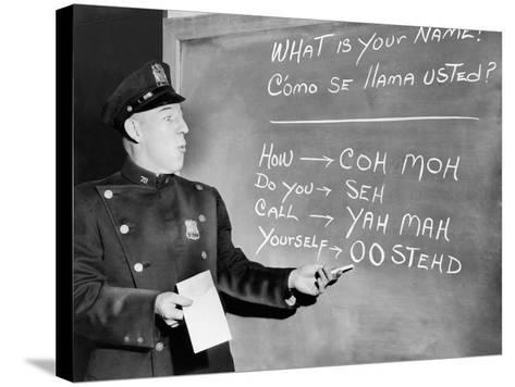 NYC Police Officer Practices Basic Spanish Phrases Written on Blackboard, Ca. 1955--Stretched Canvas Print