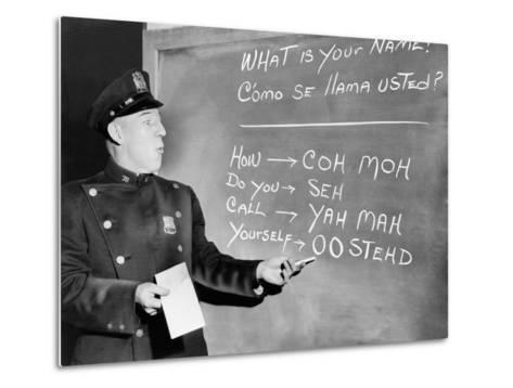 NYC Police Officer Practices Basic Spanish Phrases Written on Blackboard, Ca. 1955--Metal Print