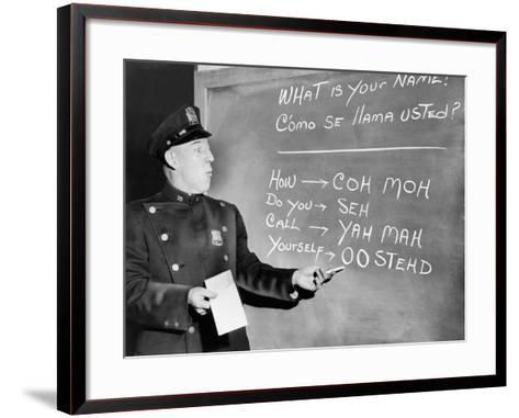 NYC Police Officer Practices Basic Spanish Phrases Written on Blackboard, Ca. 1955--Framed Art Print