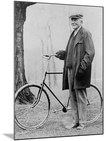 John D. Rockefeller 1939-1937 with His Bicycle after His Retirement, 1913--Mounted Photo