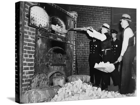 Federal Bureau of Narcotics Agents Shovel Confiscated Heroin Blocks into Incinerator in 1936--Stretched Canvas Print