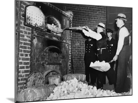 Federal Bureau of Narcotics Agents Shovel Confiscated Heroin Blocks into Incinerator in 1936--Mounted Photo