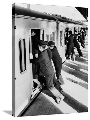 Japanese Students Employed as Uniformed 'Pushers' Cramming Commuter Cars, 1962--Stretched Canvas Print