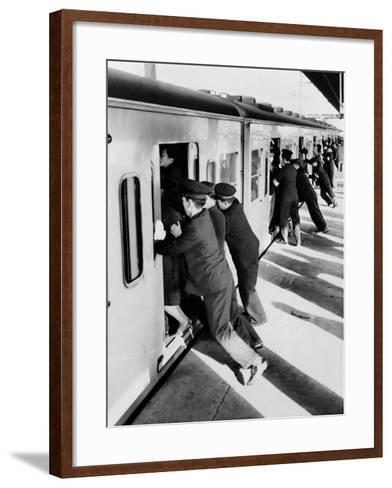 Japanese Students Employed as Uniformed 'Pushers' Cramming Commuter Cars, 1962--Framed Art Print