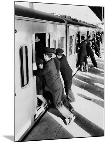 Japanese Students Employed as Uniformed 'Pushers' Cramming Commuter Cars, 1962--Mounted Photo