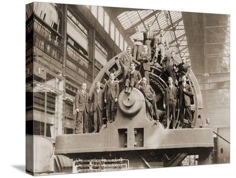 Businessmen Pose on a Giant Westinghouse Electrical Generator, 1918--Stretched Canvas Print
