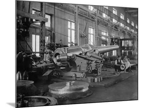 Assembled Cannon in the Foundry of the Washington Navy Yard, 1900--Mounted Photo