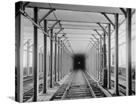 The New York City Subway Tracks at a Station with a Dark Tunnel in the Distance, 1904--Stretched Canvas Print