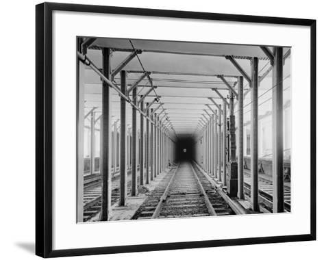 The New York City Subway Tracks at a Station with a Dark Tunnel in the Distance, 1904--Framed Art Print
