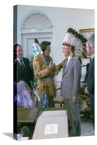 Jimmy Carter Wearing a Feathered Headdress with 'Iron Eyes' Cody , April 21, 1978--Stretched Canvas Print