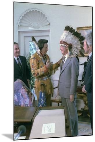 Jimmy Carter Wearing a Feathered Headdress with 'Iron Eyes' Cody , April 21, 1978--Mounted Photo