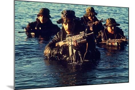US Navy SEAL Team Emerges from Water During Warfare Training, Dec. 1, 1986--Mounted Photo