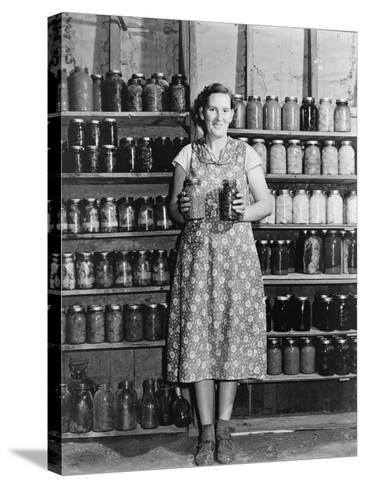 Housewife Proudly Displays Her Home Grown and Canned Food. Colorado, Sept. 1939--Stretched Canvas Print