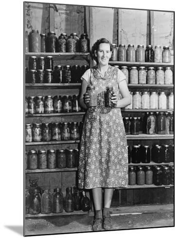 Housewife Proudly Displays Her Home Grown and Canned Food. Colorado, Sept. 1939--Mounted Photo
