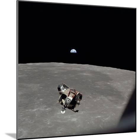 The Apollo 11 Lunar Module Ascending from Moon's Surface, July 20, 1969--Mounted Photo