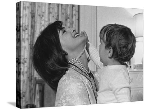 Jackie Kennedy Laughs as Her Son John Jr, Plays with Her Pearl Necklace, Nov.1962--Stretched Canvas Print