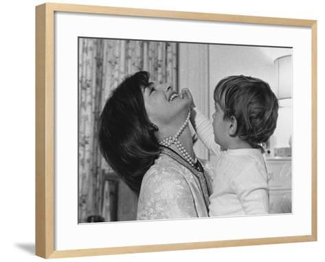 Jackie Kennedy Laughs as Her Son John Jr, Plays with Her Pearl Necklace, Nov.1962--Framed Art Print