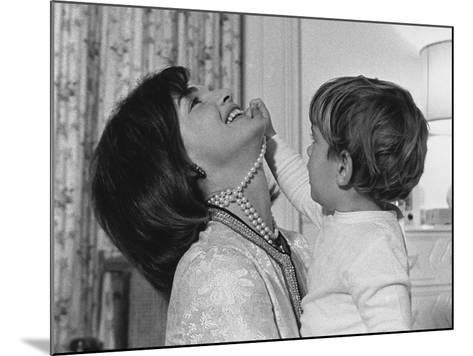 Jackie Kennedy Laughs as Her Son John Jr, Plays with Her Pearl Necklace, Nov.1962--Mounted Photo