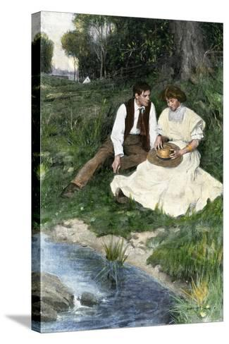 Young Couple Seated by a Brook, Early 1900s--Stretched Canvas Print