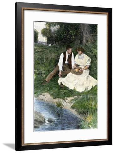 Young Couple Seated by a Brook, Early 1900s--Framed Art Print