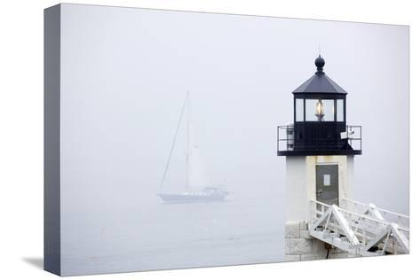 A Sailboat Passing Marshall Point Lighthouse in Port Clyde, Maine-John Burcham-Stretched Canvas Print
