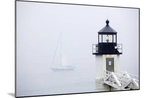 A Sailboat Passing Marshall Point Lighthouse in Port Clyde, Maine-John Burcham-Mounted Photographic Print
