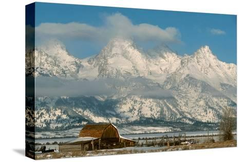 The Snow Covered Grand Tetons Rise Above the Mormon Row Barn-Ira Block-Stretched Canvas Print