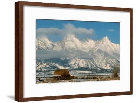 The Snow Covered Grand Tetons Rise Above the Mormon Row Barn-Ira Block-Framed Art Print