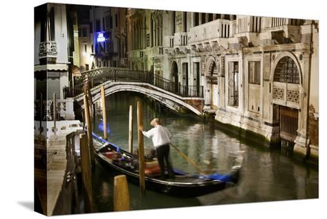 A Gondolier in a Quiet Canal At Night in Venice, Italy-Ira Block-Stretched Canvas Print