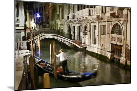 A Gondolier in a Quiet Canal At Night in Venice, Italy-Ira Block-Mounted Photographic Print