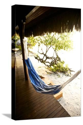 A Hammock Outside a Room At Medjumbe Island Resort in Mozambique-Jad Davenport-Stretched Canvas Print