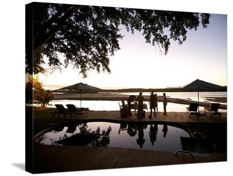Drinks By the Pool At Lugenda Wilderness Camp in the Niassa Reserve-Jad Davenport-Stretched Canvas Print