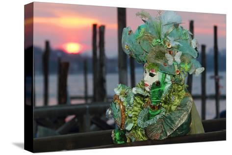 A Woman in a Mask and Costume for Carnival At a Gondola Stand-Joe Petersburger-Stretched Canvas Print
