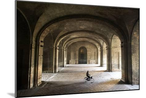 A Bicyclist Passes Through Archways in Palazzo Della Pilotta-Dave Yoder-Mounted Photographic Print