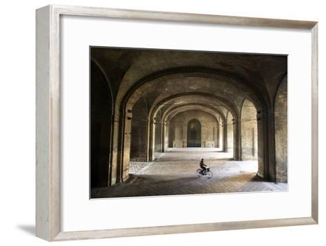 A Bicyclist Passes Through Archways in Palazzo Della Pilotta-Dave Yoder-Framed Art Print