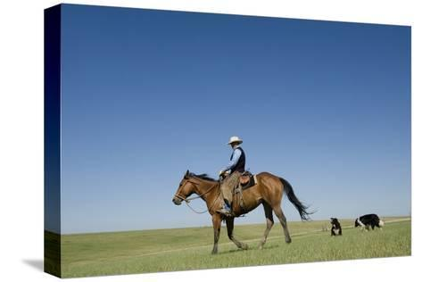 A Cowboy Rides His Horse On a Ranch Near Fort Pierre-Joel Sartore-Stretched Canvas Print