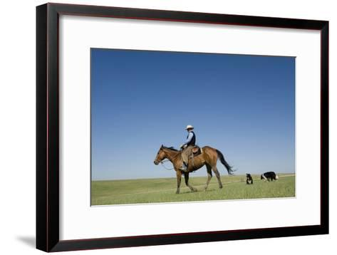 A Cowboy Rides His Horse On a Ranch Near Fort Pierre-Joel Sartore-Framed Art Print