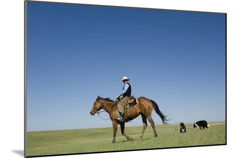 A Cowboy Rides His Horse On a Ranch Near Fort Pierre-Joel Sartore-Mounted Photographic Print