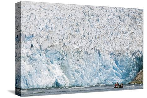 Ecotourists in a Zodiac in Front of Dawes Glacier-Rich Reid-Stretched Canvas Print