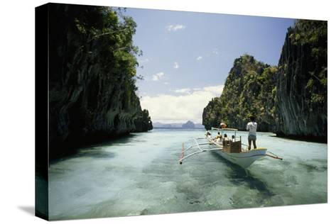 A Tourist Boat Travels Through the Islands of the El Nido Area-Paul Chesley-Stretched Canvas Print