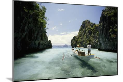 A Tourist Boat Travels Through the Islands of the El Nido Area-Paul Chesley-Mounted Photographic Print