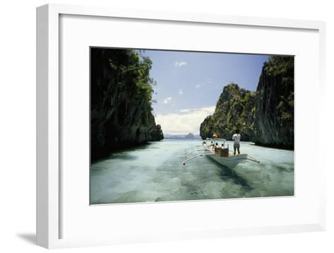 A Tourist Boat Travels Through the Islands of the El Nido Area-Paul Chesley-Framed Art Print